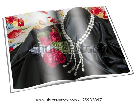 Newspaper with pictures of necklace on white background - stock photo