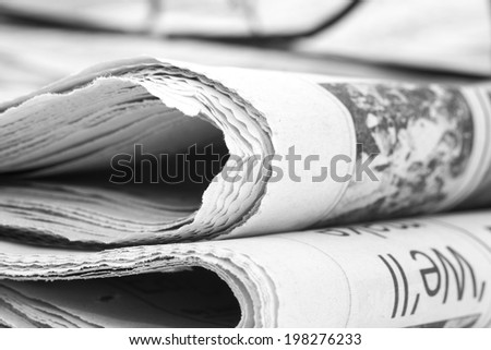 Newspaperfolded up with specs - stock photo