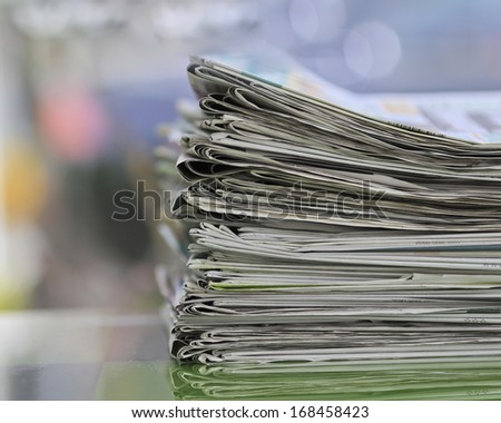Newspapers folded and stacked concept for global communications. - stock photo