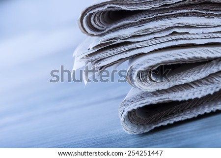 Newspapers folded and stacked concept for global communications. Newspapers folded and stacked on the table - stock photo