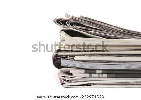 Newspapers folded, conceptual image for global communications. Macro image with shallow depth of focus  - stock photo