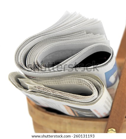 Newspapers in basket  - stock photo