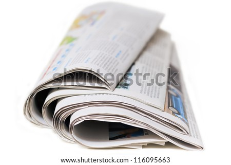 Newspapers isolated on a white background - stock photo