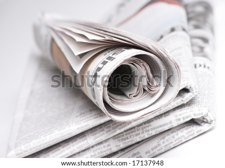 Newspapers on light background shot with very shallow depth of focus - stock photo
