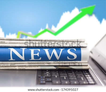 Newspapers on the laptop. Online news.  - stock photo