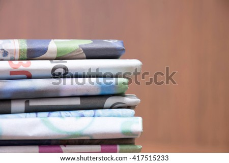 Newspapers stacked. - stock photo