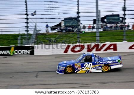 Newton Iowa, USA - July 11, 2014: NASCAR Camping World Truck Series, American Ethanol 200. Iowa Speedway. 29 Ryan Blaney, Ford, Brad Keselowski Racing - night racing - stock photo