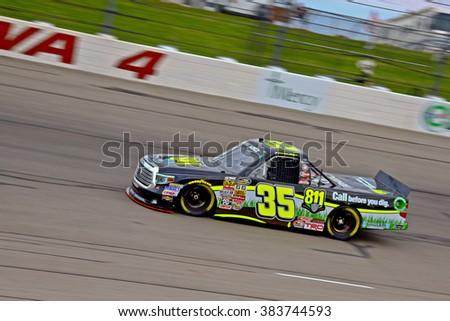 Newton Iowa, USA - July 11, 2014: NASCAR Camping World Truck Series, American Ethanol 200. Iowa Speedway. 35 Mason Mingus, Toyota, Win-Tron Racing - stock photo
