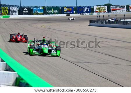 Newton, Iowa USA - July 17, 2015: Verizon IndyCar Series Iowa Corn Indy 300. 11 Sebastien Bourdais Le Mans, France Team Mistic E-Cigs - KVSH Racing Chevrolet KVSH Racing. Rounds corner on race track. - stock photo
