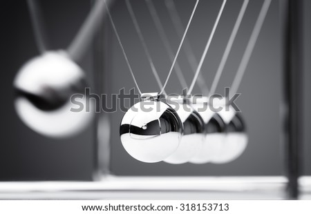 Newton's cradle physics concept for action and reaction or cause and effect - stock photo