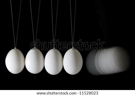 "Newton's eggs cradle. Concept of ""action-reaction"". - stock photo"