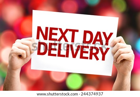 Next Day Delivery card with colorful background with defocused lights - stock photo