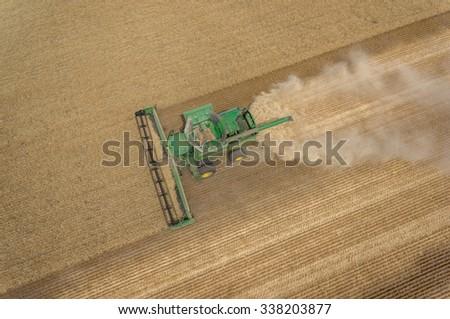 NEZPERCE, IDAHO/USA  AUGUST 9, 2015: Aerial view of a John Deere S690 combine harvesting a field of wheat in Idaho.  - stock photo