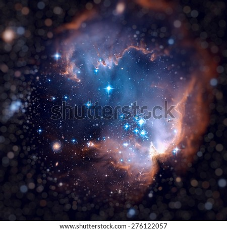NGC 602 (N90) is a young open cluster of stars located in the Small Magellanic Cloud, a satellite galaxy to the Milky Way. Retouched image with small DOF. Elements of this image furnished by NASA.  - stock photo