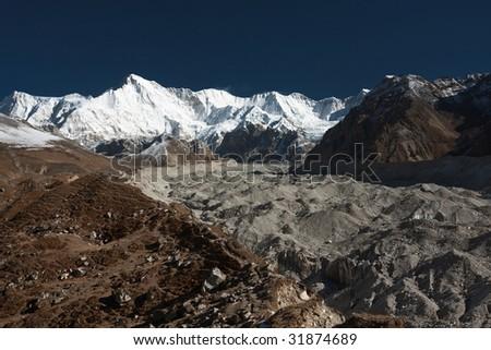 Ngozumba glacier and Cho Oyu 8202m. Himalayas, Nepal - stock photo
