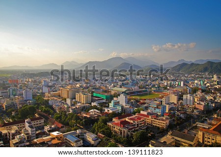 Nha Trang city panorama with mountains Vietnam - stock photo