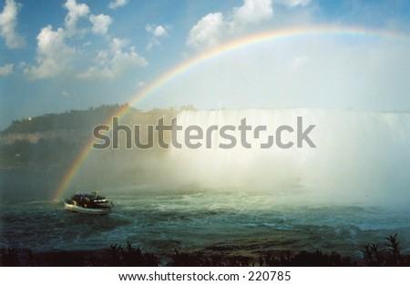Niagara boat tour and the rainbow. - stock photo