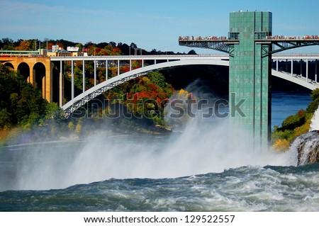 niagara falls and rainbow bridge connected usa and canada - stock photo