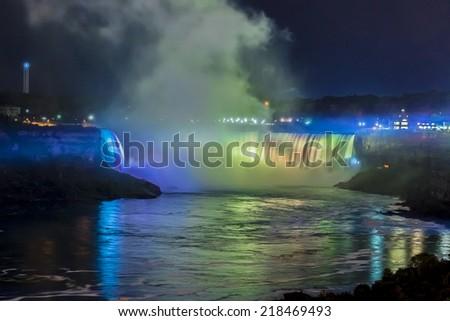 Niagara Falls closeup panorama by night. Ontario, Canada. - stock photo