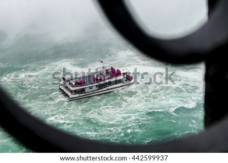 NIAGARA FALLS - MAY 29: Hornblower boat with tourists in Niagara Falls view from Canadian side in Niagara Falls on May 29, 2016 in Niagara Falls, Canada. - stock photo