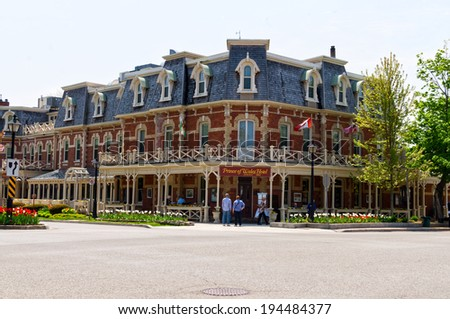 NIAGARA ON THE LAKE, ONTARIO - MAY 22, 2014: Historic Prince of Wales Hotel in Niagara On The Lake, Ontario, Canada. The three story hotel with 100 rooms was built in 1864.  - stock photo