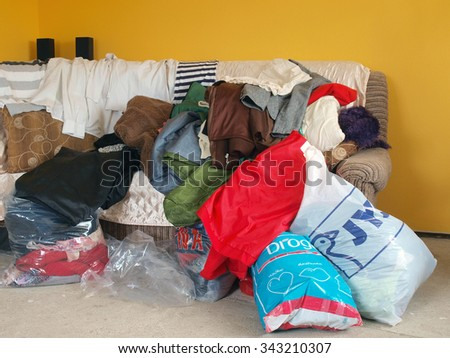 NICA, LATVIA - NOVEMBER 24, 2015: Used clothes are collected for donations to help poor people.       - stock photo