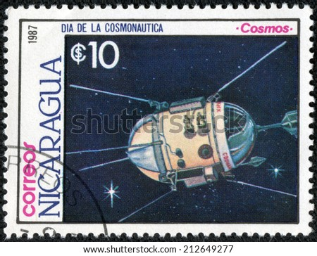 """NICARAGUA - CIRCA 1987: A stamp printed in Nicaragua from the """"Cosmonautics Day """" issue shows Cosmos satellite, circa 1987. - stock photo"""
