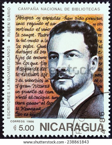 """NICARAGUA - CIRCA 1986: A stamp printed in Nicaragua from the """"National Libraries. Latin American Writers """" issue shows Ruben Dario (1867-1916), circa 1986. - stock photo"""