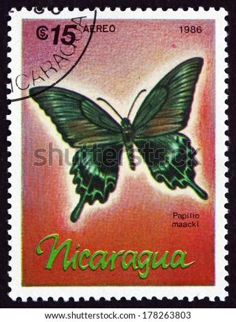 NICARAGUA - CIRCA 1986: a stamp printed in Nicaragua shows Alpine Black Swallowtail, Papilio Maacki, Butterfly, circa 1986 - stock photo