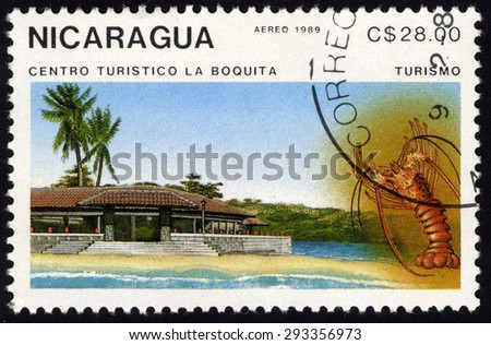 NICARAGUA - CIRCA 1989: A stamp printed in Nicaragua shows beach resort and lobster, circa 1989  - stock photo