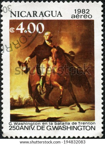 NICARAGUA - CIRCA 1982: A stamp printed in Nicaragua shows George Washington (1732-1799), Battle of Trenton, 250th birth anniversary, circa 1982 - stock photo
