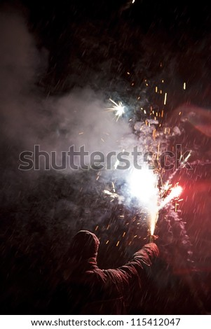 Nice abstract image of someone holding a fireworks during a snowstorm. That was a very fun moment and a nice artistic image that could represent tons of things. I have one similar images. - stock photo