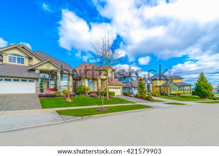 Nice and comfortable neighborhood. Houses on the empty street in the suburbs of Vancouver, Canada. - stock photo