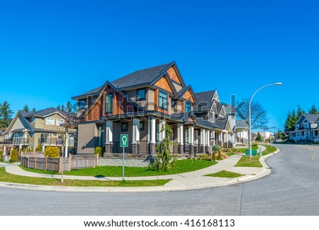 Nice and comfortable neighborhood. Some homes on empty street in the suburbs of the North America. Canada. - stock photo