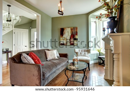 Nice and elegant living room with large fireplace. - stock photo