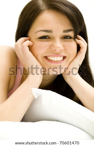 Nice and pretty woman portrait in bright light. Woman relaxing in her home. - stock photo