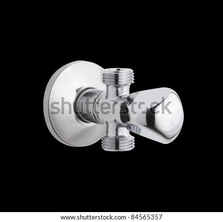 nice and shiny water heater faucet control - stock photo