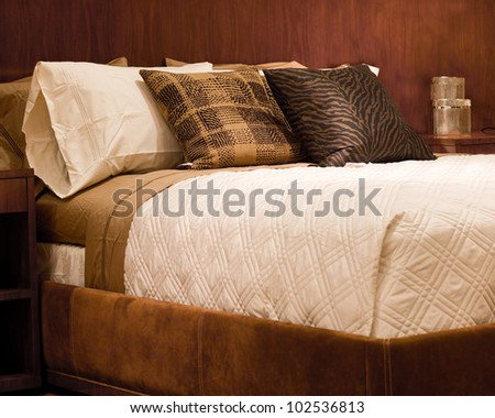 Nice Bed in typical contemporary setting - stock photo