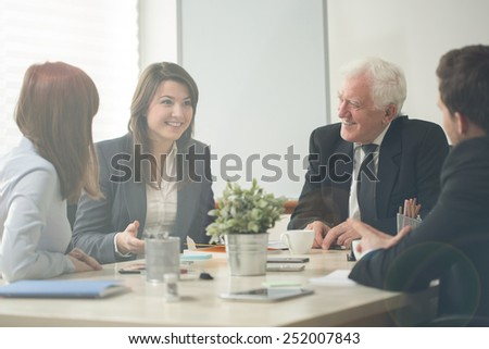 Nice business assemblage in conference room - stock photo