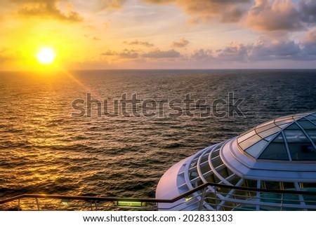 nice caribbean sunset from ship - stock photo