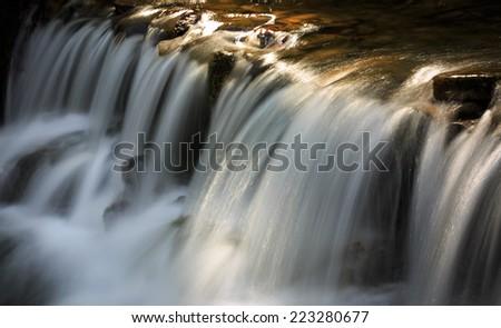 Nice cascade on mountain brook - stock photo