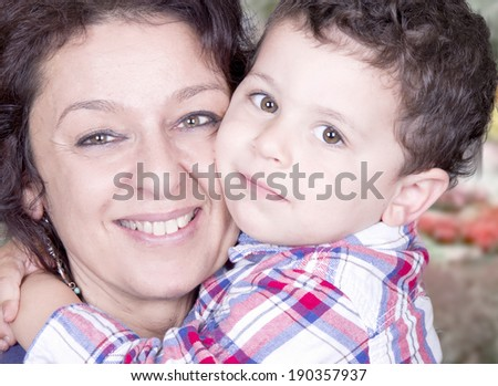 Nice Caucasian grandmother with her grandson  - stock photo