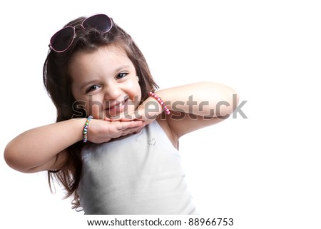 Nice child girl wearing a grey shirt isolated on white, smiling and with sunglasses in her head. - stock photo