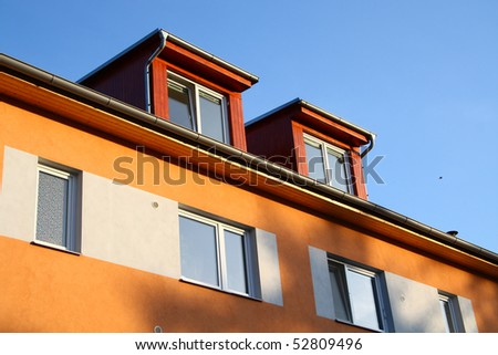 Nice dormers on the roof - stock photo