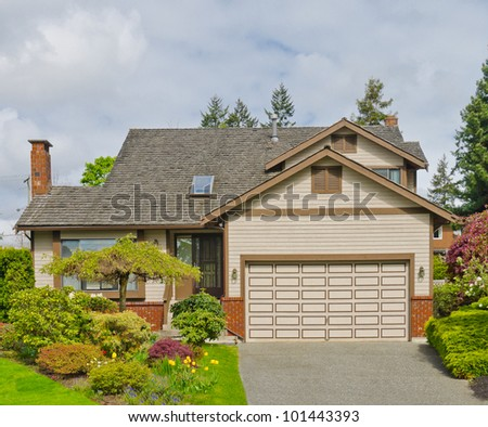 Nice double garage house in the residential neighborhood. Canada. - stock photo