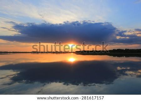 Nice evening scene on lake - stock photo