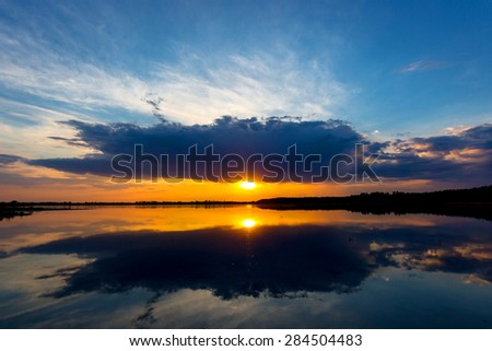 Nice evening scene with sunset over lake