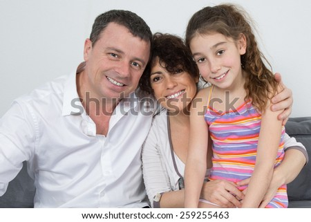 Nice family of three , parents and their girl - stock photo
