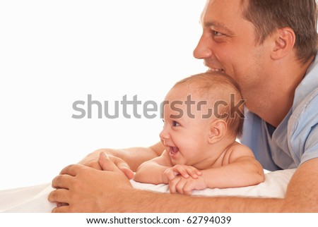 nice father and his daughter lie on a white - stock photo