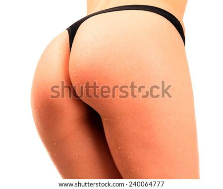 Nice female ass, white background, isolated - stock photo